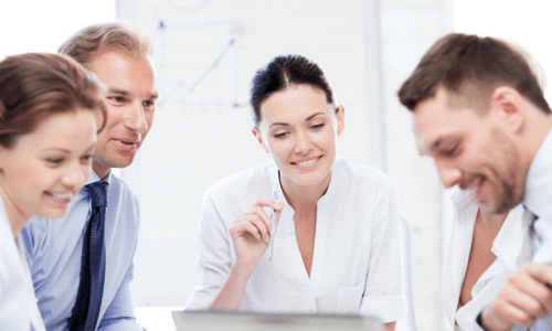 An image of four people in an office settings discussing best small business ideas in Australia this 2021 – Hart Partners